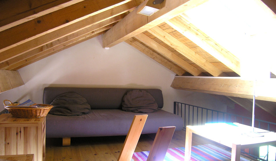 small living area on the loft above the dining rm