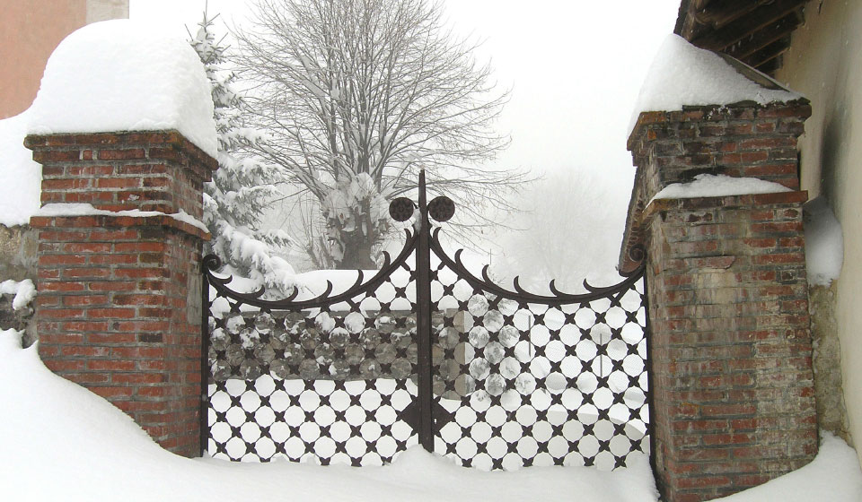 snow covered gate in the village